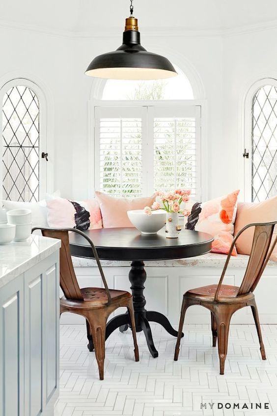 Dining Space Trend - Black Accents - Nina Dobrev kitchen nook. Industrial black pendant light, black pedestal table:
