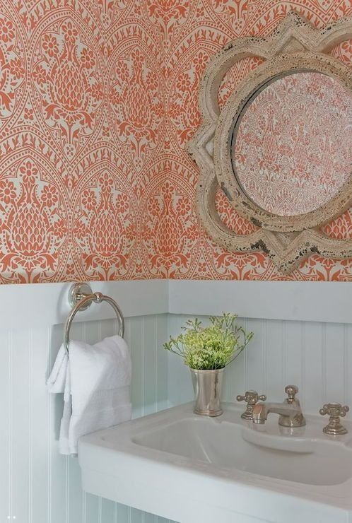 Small Spaces with Wonderful Wallpaper from apartment therapy. Love this color, pattern, and coordinating mirror: