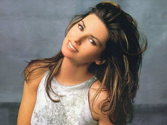 Shania Twain Born Eilleen Regina Edwards (August 28, 1965 - ) Canadian country pop singer-songwriter.: