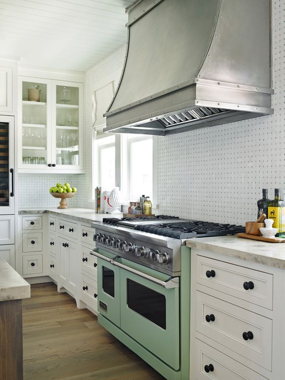 Beautiful kitchen inspiration with green stove white cabinets and tile backsplash - House of Turquoise