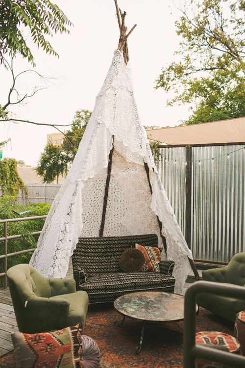 Outdoor Living Spaces Porch with Boho White Lace Tee Pee and Cushioned Seating Area