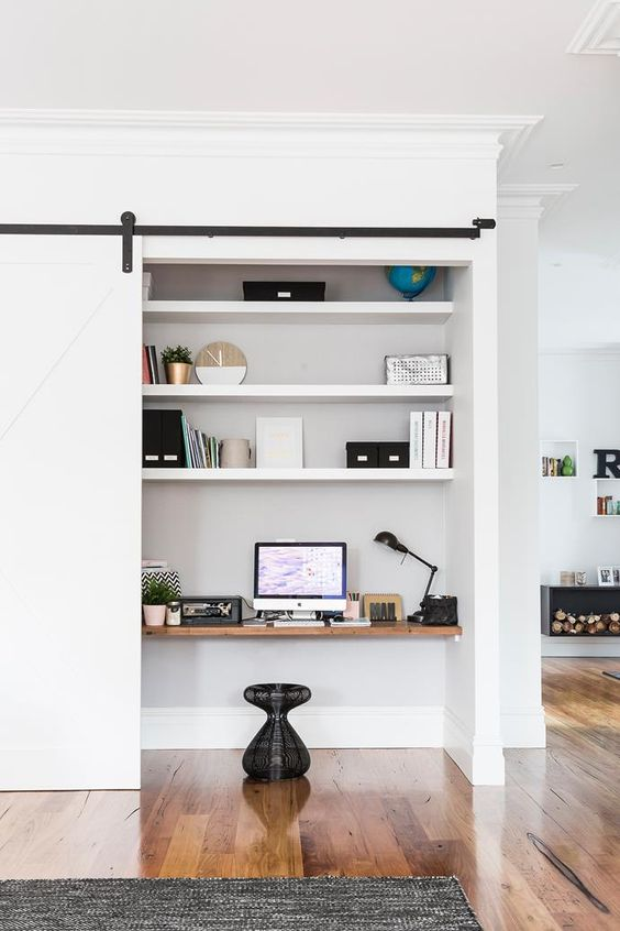 This study nook is cleverly concealed behind a sliding door within a living room. Photo: Maree Homer / bauersyndication.com.au: