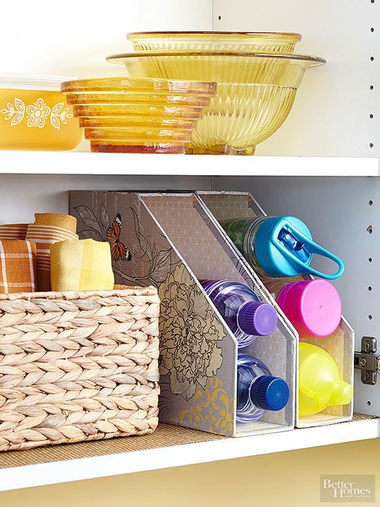 Keep water bottles within reach and in view by stacking them in magazine files.