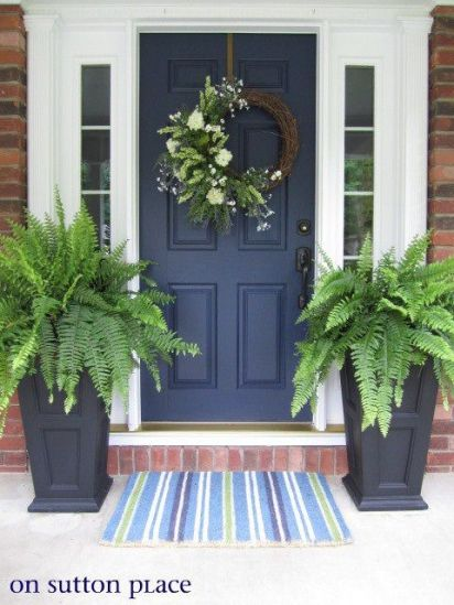 front door wreath and planters