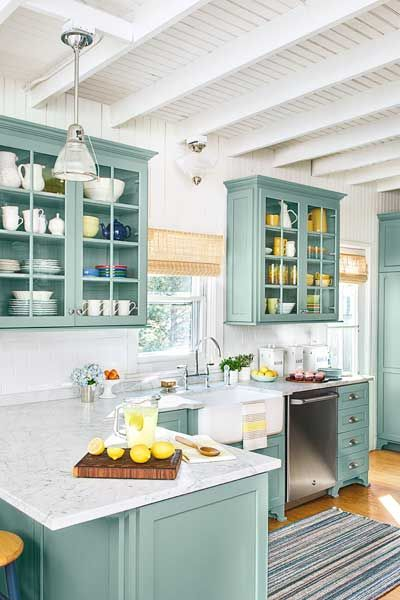 beach cottage kitchen remodel with teal custom kitchen cabinets, subway tile, marble countertops: