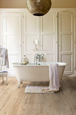 Quick-Step Impressive waterproof laminate flooring in bathroom: