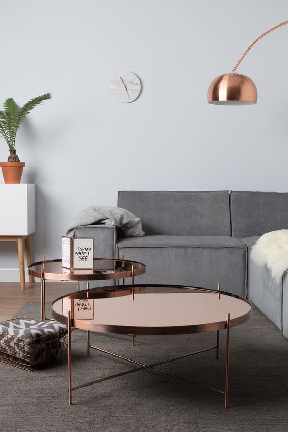 copper table, calm interiors and a cheeky plant can mean only one thing, a typical scandi inspired living space. gorgeous!:
