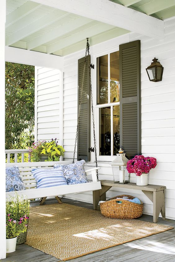 """In the South, the porch is a sacred place, and there's no better way to enjoy one than a well-designed porch swing."":"