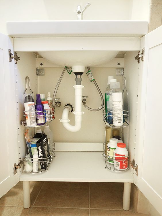 Bathroom storage - use shower caddies to keep supplies neat under the sink.