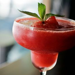 Frozen Strawberry Daiquiri (4 to 6 drinks) {1 cup white rum, 3 cups fresh strawberries,(roughly chopped), 1/4 cup lime juice Ice cubes, as needed*,} In a blender combine the rum, strawberries, fresh squeezed lime juice and one cup of ice. Pulse to evenly blend. *Depending how thick you want your frozen daiquiri you can add as much or as little ice. Start with one cup. Then if you prefer it a little more slushy add more ice, a 1/2 cup at a time and pulse to blend to your desired consistency.: