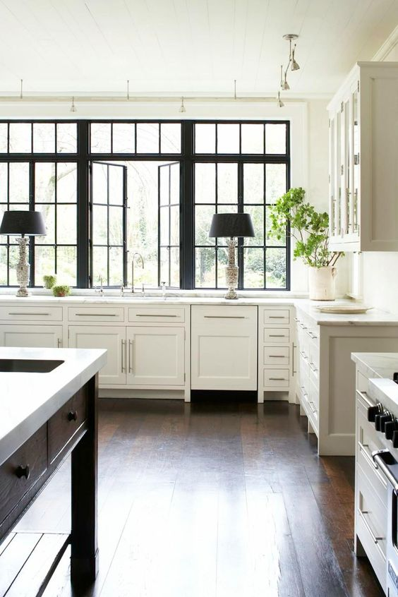 If you've got beautiful natural light streaming into a room or windows with extra architectural detail, then there's no reason to hide them behind curtains. Go au naturel by foregoing the curtains and other adornments, like Carter Kay did in the design of this Atlanta kitchen.: