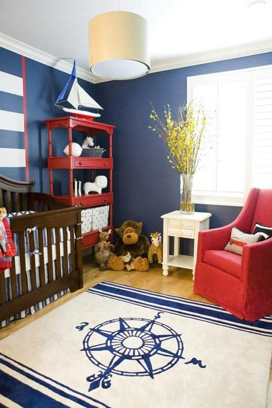 Nautical toddler room. Love that rug.  this could work down the road with a toddler bed: