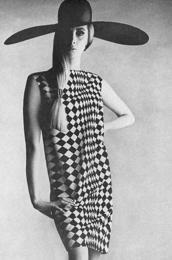 Wilhelmina in a diamond patterned dress by Charles Cooper, photo by Penn for Vogue, 1966: