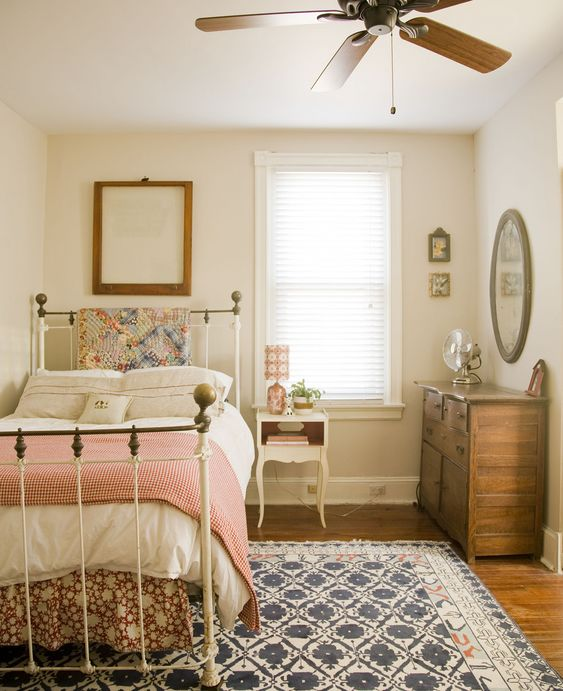A Simple Cottage Bedroom With A Twin Bed With Metal Frame