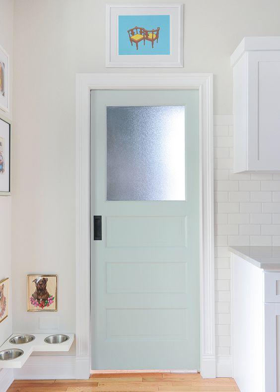 Kitchen pocket door color: Swept Away by Benjamin Moore. Cute little doggie corner.: