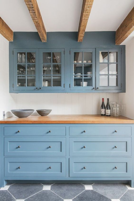 13 New Kitchen Trends - light blue cabinets, butcher block countertop, exposed beams, glass front cabinets: