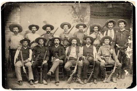 TEXAS RANGERS — (Standing from left) Jim King, Bass Outlaw, Riley Boston, Charley Fusselman, Tink Durbin, Ernest Rogers, Charles Barton and Walter Jones. (Seated, from left) Bob Bell, Cal Aten, Captain Frank Jones, J. Walter Durbin, Jim Robinson and Frank L. Schmid. – Courtesy Texas Ranger Research Center; Texas Ranger Hall of Fame & Museum —:
