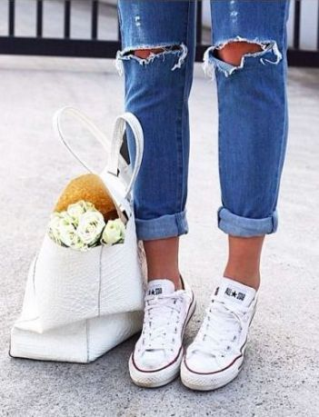 chuck taylors + ripped jeans: