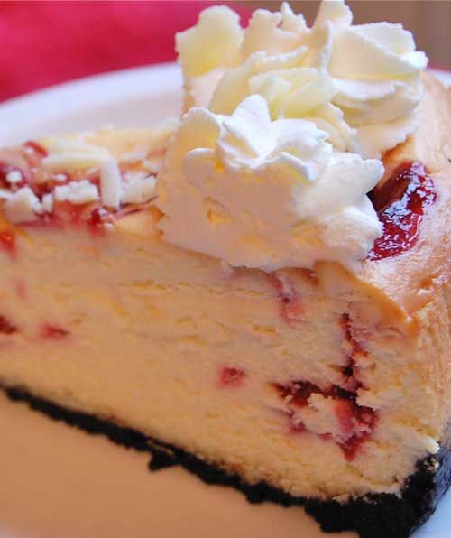 Recipe for Copycat Cheesecake Factory White Chocolate Raspberry Truffle Cheesecake - I like a rich cheesecake with nice height to it and I think a generous swirl of fresh whipped cream on top looks so nice.: