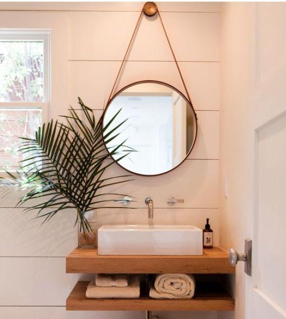 Banheiro com espelho redondo: