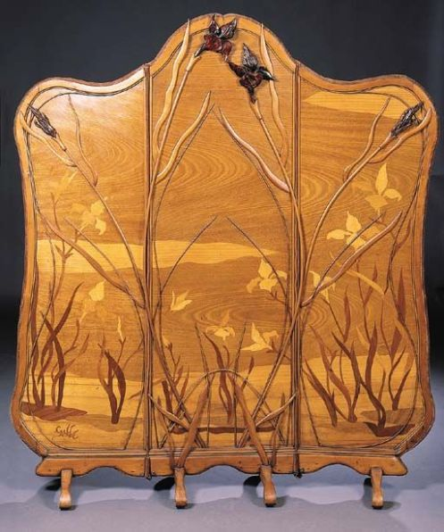 Émile Gallé (1846-1904) - Three-Section Irises Screen. Carved Mahogany and Fruit Wood Marquetry Inlays, reverse Upholstered in Red Velvet Fabric. Nancy, France. Circa 1900. 155cm x 173cm.: