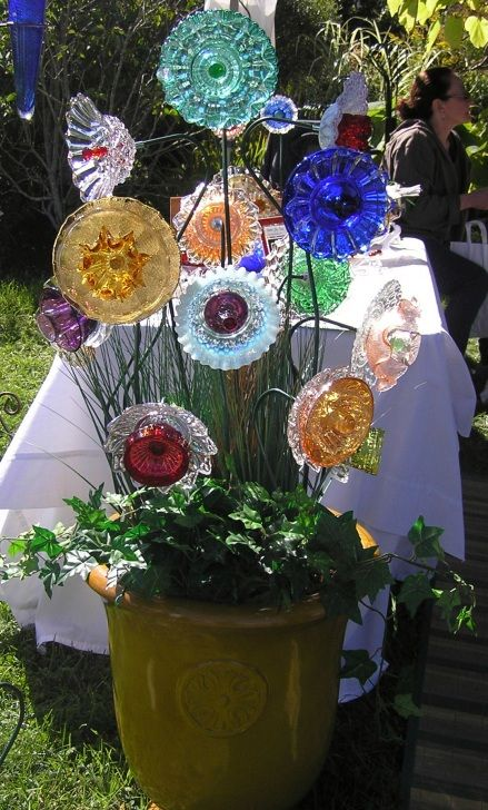 Thrift store glass plates into garden flowers.: