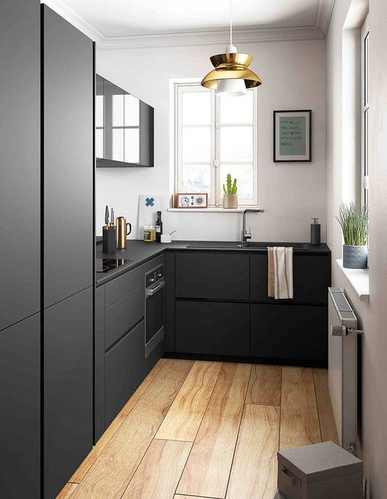 Amazing black kitchen! Love the contrast with the floorboards. Add warmth to dark spaces with timber.: