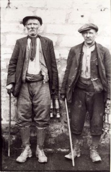 1900 work clothes   wall; both men are middle-aged and are dressed in work clothes ...: