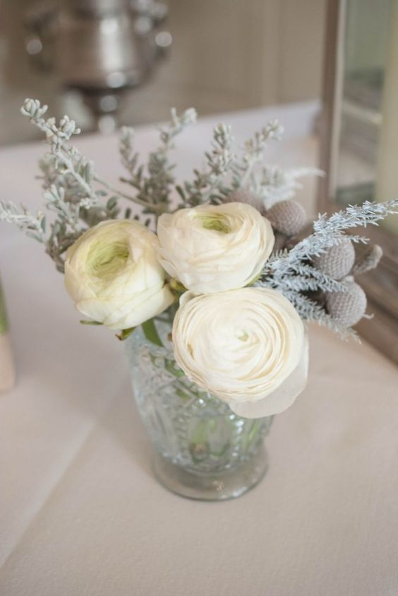 Winter wedding flowers - Small glass votive with white ranunculus - by Laurel Weddings: