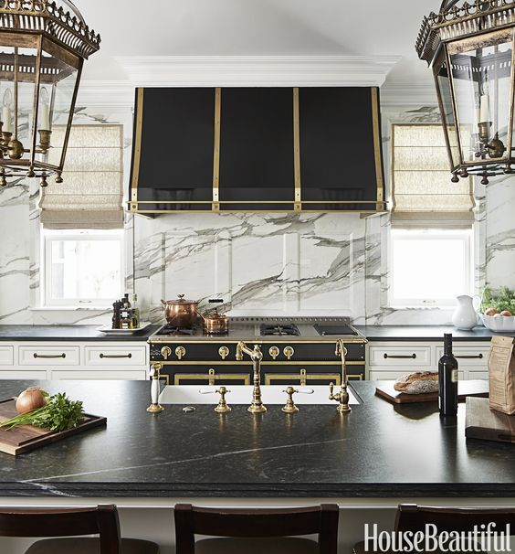 Old and new, stone and metal, brass and black, polished and matte. This kitchen is full of juxtapositions. Designed by Frank Ponterio:
