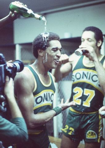 Sonics forever — Champaign is poured on Dennis Johnson's head after the Sonics defeat the Washington Bullets for the 1979 NBA Championship.: