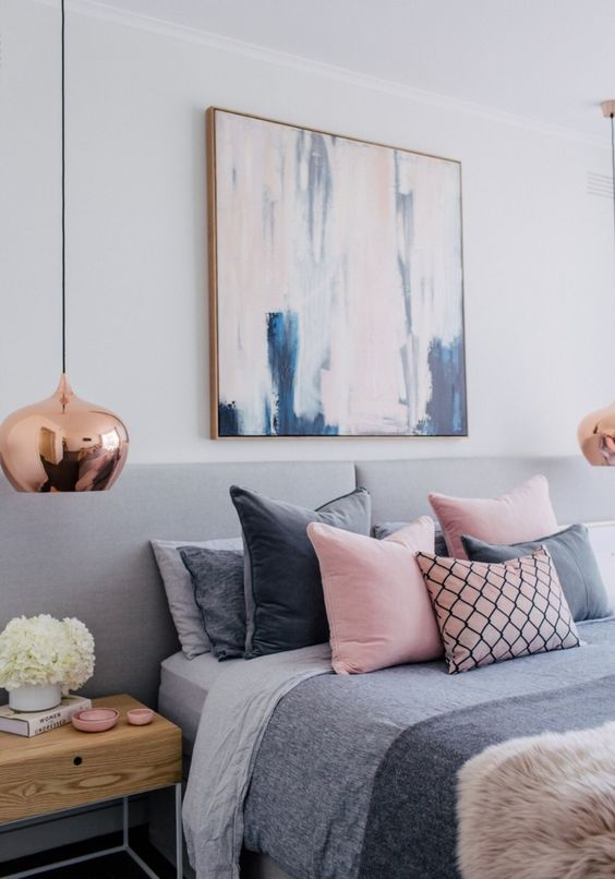 Bedroom inspiration for a great and pink Blush scheme with copper, textures and coloured cushion in grey, pink and pattern. Amazing artwork above the bed.: