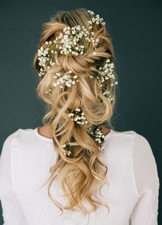 11 Effortlessly Romantic Wedding Hairstyles: Who knew baby's breath could look so magical? Simply twist and pin random, large pieces of curled hair, then add texture with finishing spray. Hair & Makeup by Steph: