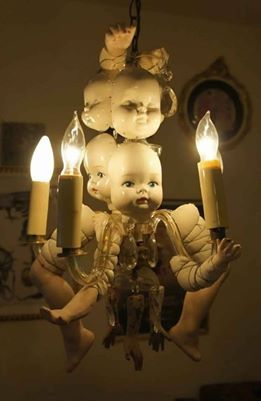 Some creepy home decor.. thrift store here I come, chandalier check, baby dolls, check: