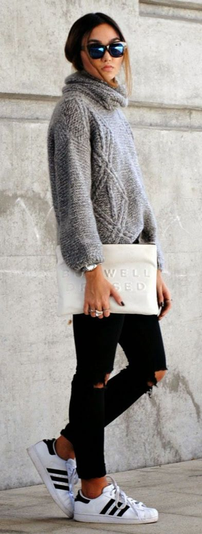 Konni Lechler in her grey knitwear roll neck, black jeans and white clutch from Zara and the sneakers are from Adidas: