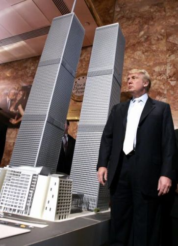 Donald Trump standing besides the model of the Trump World Trade Center