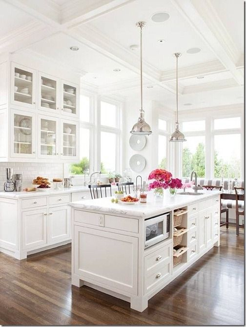 Love this look - white on white, glass front cabs, white/gray counters, industrial fixtures.: