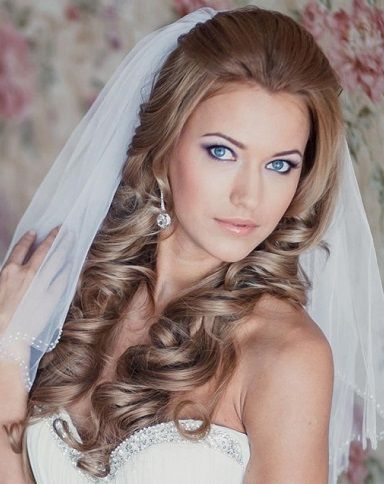 half up half down wedding hairstyle with loose bouncy curlsis style looks perfect under the