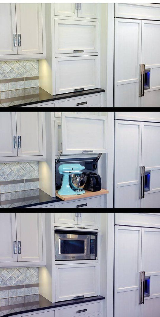 Really like the lift up door for appliances, and slide back door above it for the microwave. Clear Counter Clutter: 10 Inspiring Appliance Garages: