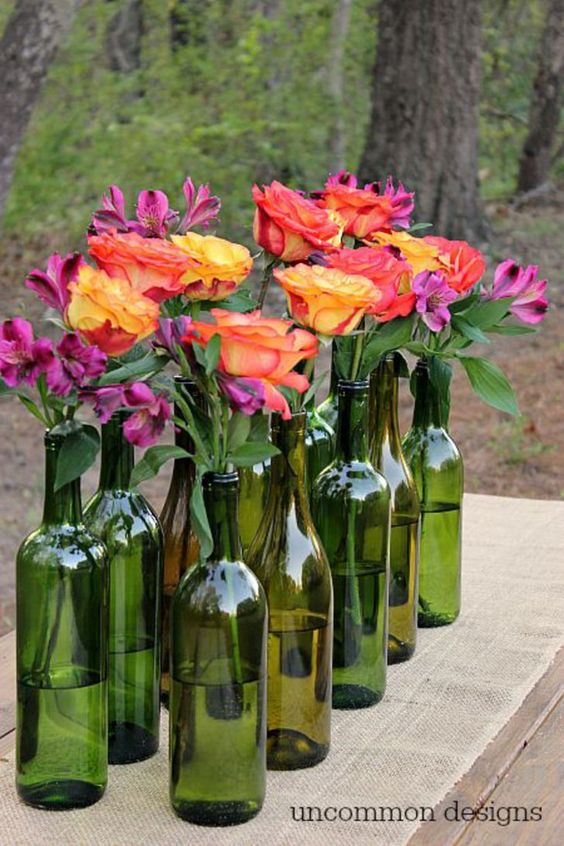 Pin for Later: 15 Inspired Ways to Decorate With Empty Wine Bottles A Simple Centerpiece The team at Uncommon Designs details how to make a simple centerpiece from collected and cleaned green wine bottles.