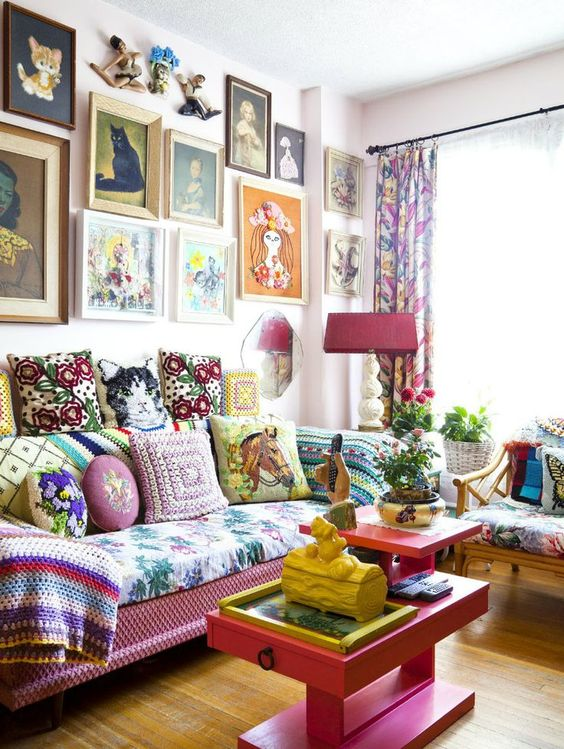 John Webster interior with ecclectic retro furnishings including cat portraits and crochet pillows: