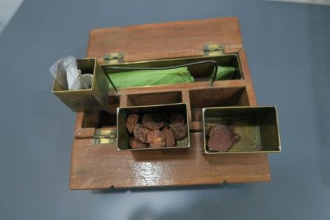 My great-grandmother's betel-nut box. The nuts (sliced, for convenience of chewing) are in the middle compartment.