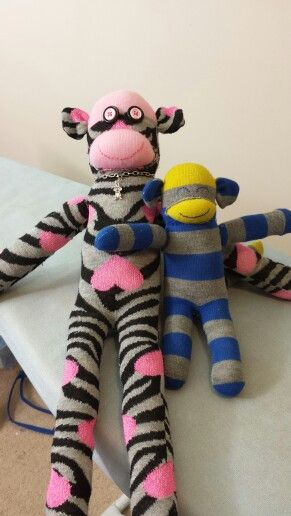 It's been a while since I've made a sock monkey.  Love the sock monkey charm I found for the big one.: