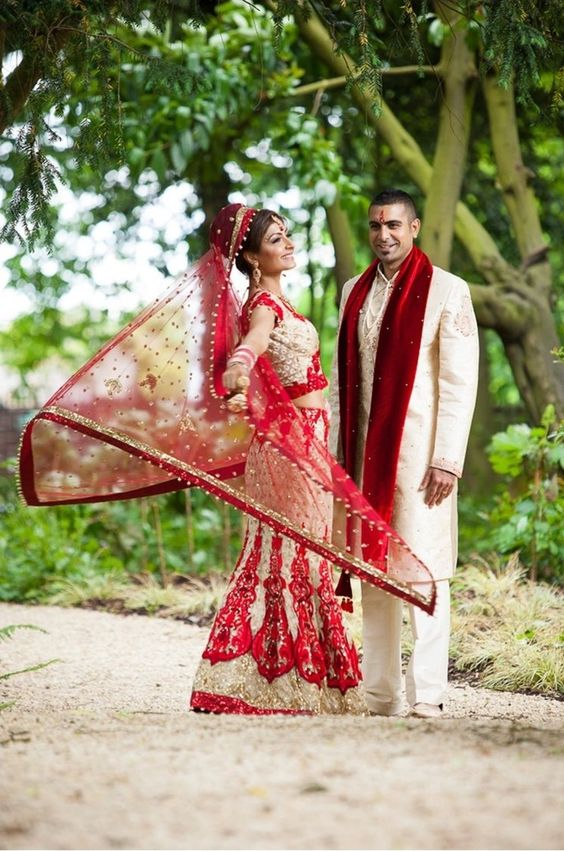 Enjoying beautiful day together Indian wedding couple