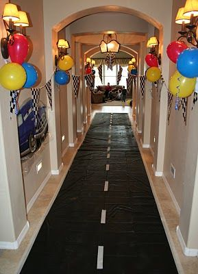 This is an awesome idea for a birthday party. Cars party or Hot Wheels party - use a black plastic table cloth and add white lines to make a highway - car theme: