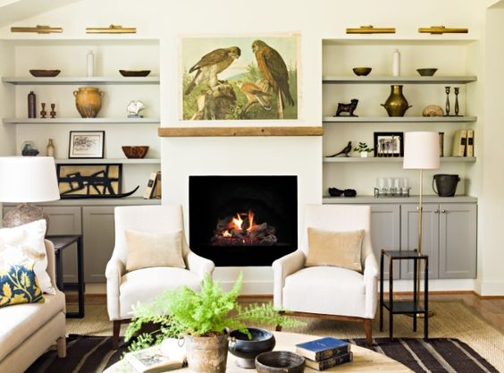 Lauren Liess | Pure Style Home | The natural woods, the vintage kilim layered over the seagrass rug, the linens, the velvet, the vintage bird chart above the fireplace, the collection of quirky antique and vintage objects on the shelves... all of my favorite things.: