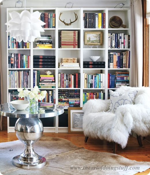 Love this set of bookshelves and the whole article about how to arrrange items on bookshelves.: