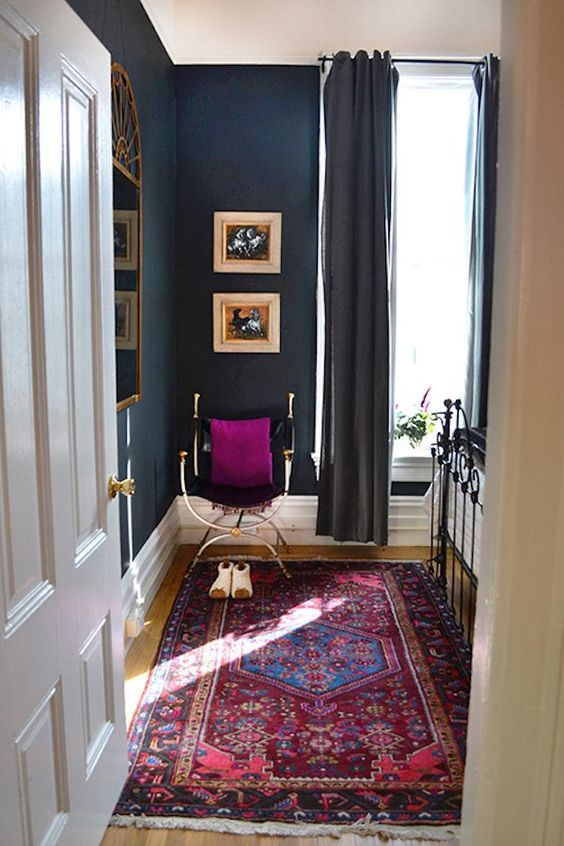Moody Blue Bedroom with Colorful Persian Rug: