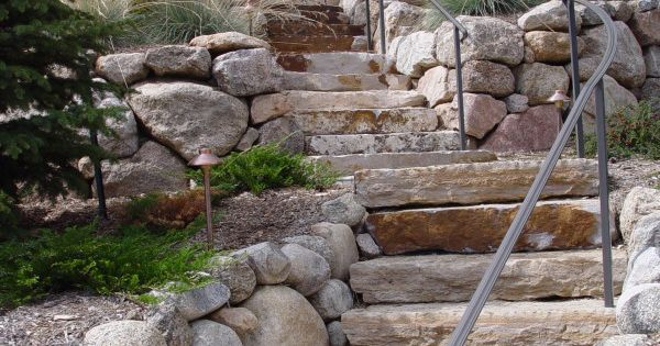 Round Stone Walls And Stone Slab Steps Mediterranean