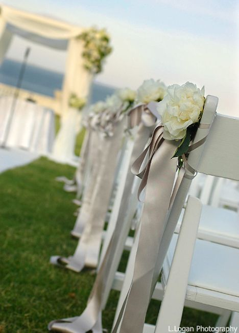 Taupe Satin Ribbons Hanging From White Garden Chairs